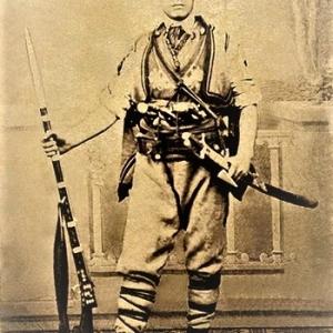 Като знаменосец на четата на Панайот Хитов през 1867 (фотография от 1867 г., Белград)